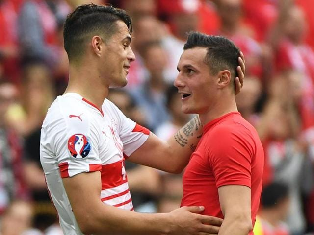 Switzerland's Granit Xhaka, left, talks to his brother, Albania's Taulant Xhaka at the end of the Euro 2016 match between Albania and Switzerland, at the Bollaert stadium in Lens, France, on June 11, 2016.