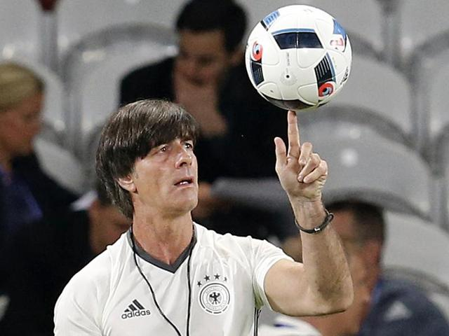 Coach Joachim Loew juggles with the ball during a training session of the German national team.