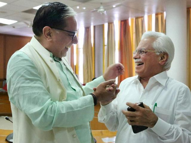 BJP supported candidate for Rajya Sabha, Zee Media Chairman, Subhash Chandra and Indian National Lok Dal & Congress supported candidate for Rajya Sabha RK Anand, during polling in Chandigarh on Saturday.(PTI)