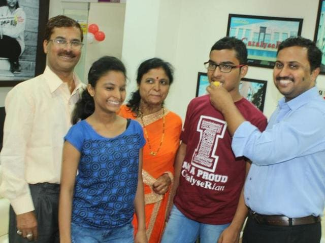 Kartik Patekar, 17, celebrates his success in the JEE Advanced with his parents, younger sister and teacher in Indore on Sunday.