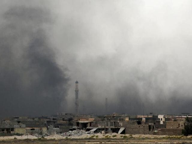 Smoke billows from Fallujah's southern Shuhada neighbourhood following shelling during an operation by Iraqi government forces.