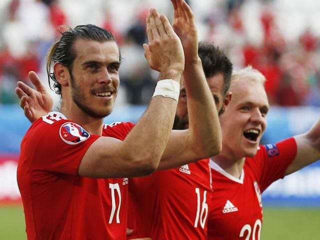 Wales' Gareth Bale celebrates after Wales' Hal Robson-Kanu scores their second goal.
