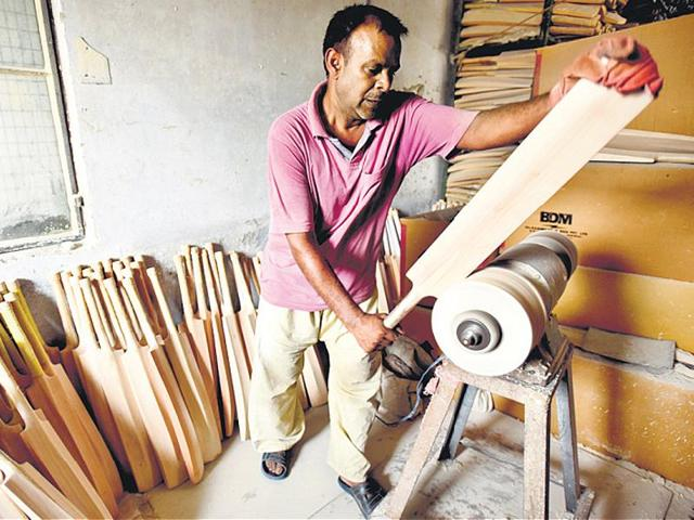 A craftsman at work at a manufacturing unit in Meerut. The popularity of T20 cricket has pushed up the demand for lighter bats but with extra thickness.