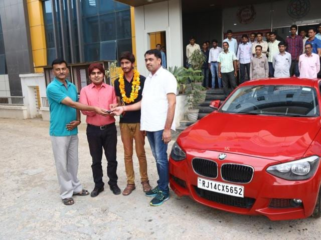 A coaching institute in Rajasthan's Sikar has gifted the luxury vehicle to Tanmaya Shekhawat for securing the 11th position in the IIT-Joint Entrance Exam (Advanced).