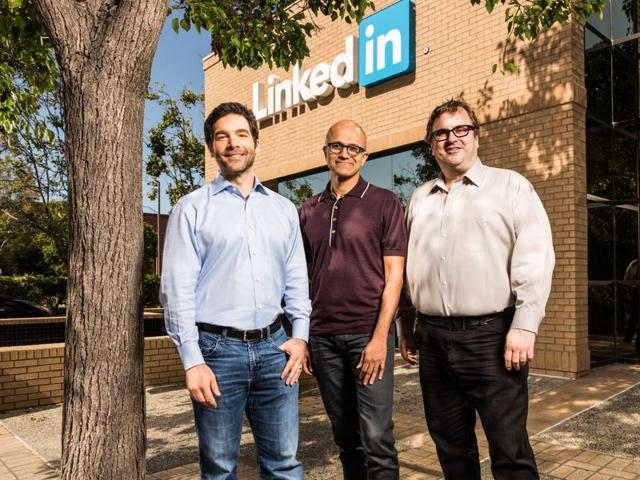 From left: LinkedIn CEO Jeff Weiner, MIcrosoft CEOSatya Nadella and founder Reid Hoffman stand infront of the LinkedIn headquarters in Mountain View, California.