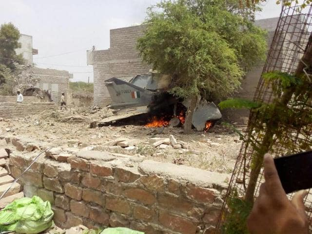 A MIG-27 crashed in a residential area of Jodhpur city on Monday, June 13, 2016. The pilot was able to eject safely.