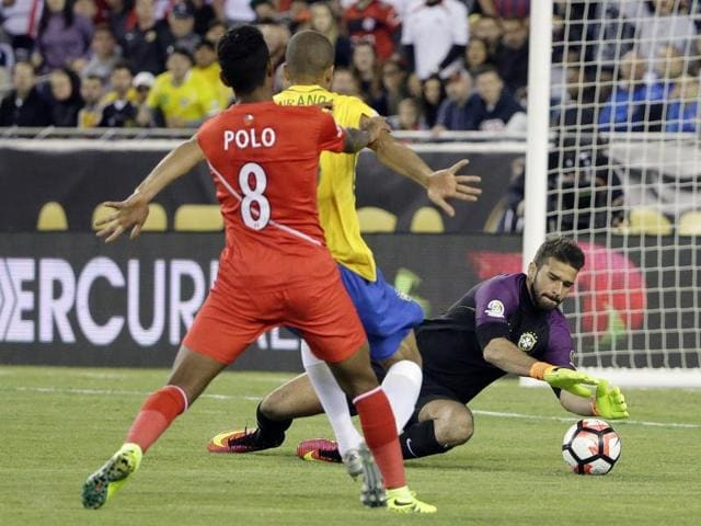 Brazil defender Gil (4) and Brazil midfielder Renato Augusto (18) go over Peru forward Jose Paolo Guerrero (9) for a header during the first half of the group play stage of the 2016 Copa America Centenario, at Gillette Stadium.