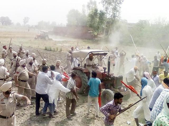 Farmers and labourers clashing at Machhi Nangal village in Ajnala near Amritsar on Sunday.
