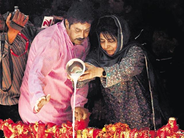 Jammu and Kashmir chief minister Mehbooba Mufti offers prayers at the Kheer Bhawani temple on the occassion of annual Mela in Ganderbal District in Srinagar on Sunday.