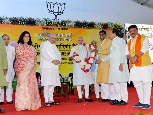 Prime Minister Narendra Modi is garlanded by party leaders during the party's national executive meet in Allahabad on Sunday.