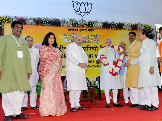 Prime Minister Narendra Modi is garlanded by party leaders during the BJP's national executive meet in Allahabad on Sunday.