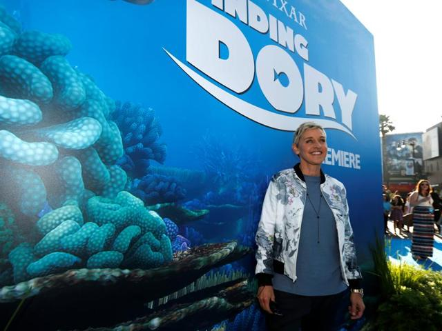 Ellen DeGeneres squirts a water gun at the premiere of Finding Dory at the El Capitan Theatre.