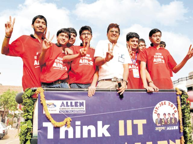 JEE Advanced, 2016 topper Aman Bansal along with other top scorers from Kota's Allen Career Institute during a success rally in Kota on Monday.
