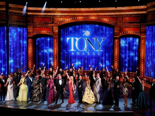 Show host James Corden (front, C) performs with all the nominees during the American Theatre Wing's 70th annual Tony Awards in New York, on Sunday.