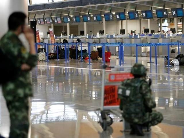 A bomb disposal expert checks luggage near the site of a blast in Shanghai Pudong international airport on Sunday.