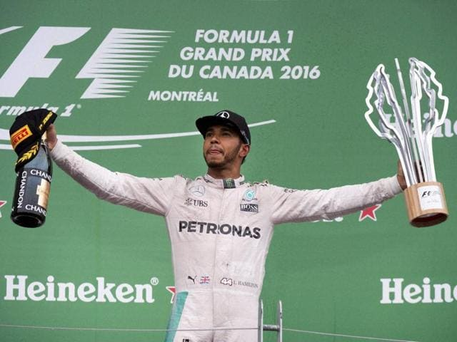 Mercedes driver Lewis Hamilton celebrates his victory at the Canadian Grand Prix auto race in Montreal.