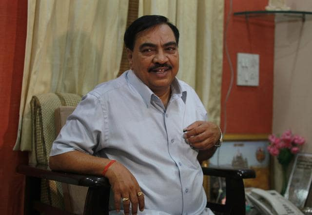 Former cabinet minister Eknath Khadse interacts with journalists in Mumbai.