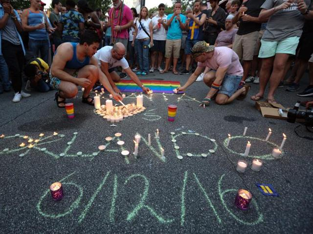 Orlando (did not want to provide his last name) who was injured in the mass shooting at the Pulse Nightclub cries as he attends a memorial service for the victims of the terror attack where Omar Mateen allegedly killed more than 50 people on June 12, 2016 in Orlando, Florida.