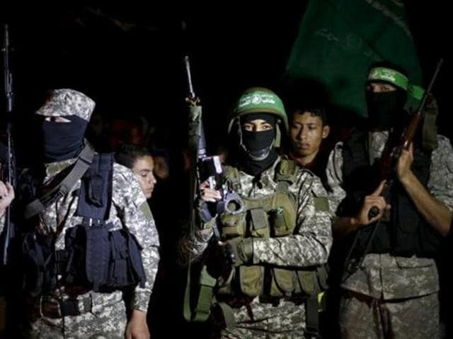Palestinian Hamas militants take part in a rally marking Palestinian Prisoners' Day in Gaza City.