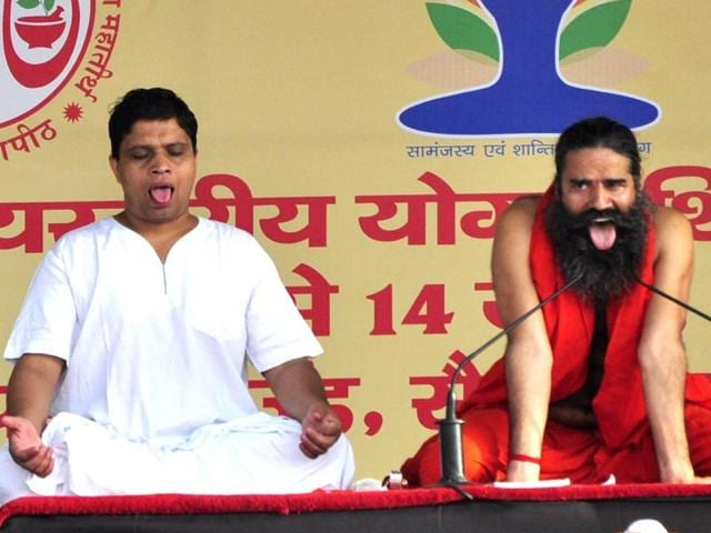 Yoga guru Ramdev and his associate Balkrishna demonstrating an 'aasana' on the first day of a three-day camp at the Sector-5 parade ground in Panchkula on Sunday.