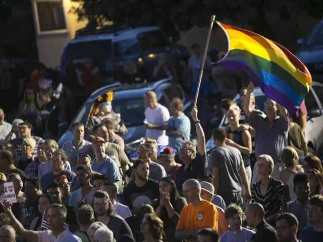 Hundreds gather to mourn the loss of dozens of Americans killed the night before in a mass-shooting in Orlando, Fla., at the Phoenix Pride LGBT Centre on Sunday, June 12, 2016, in Phoenix, Arizona.