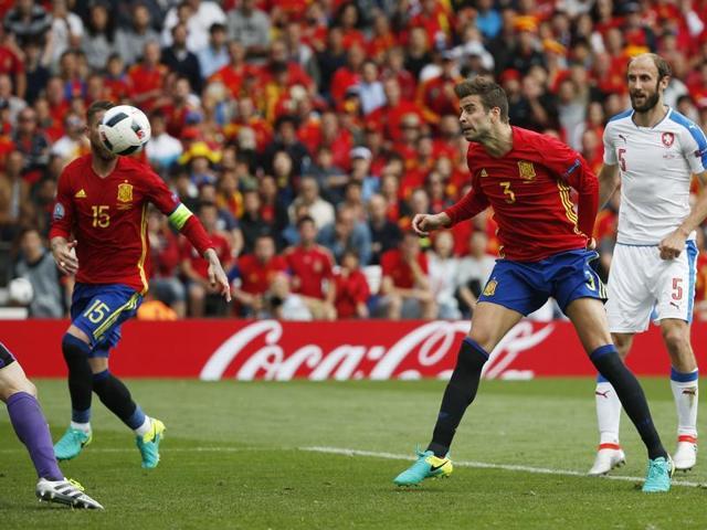 Gerard Pique celebrates after scoring the winner for Spain.