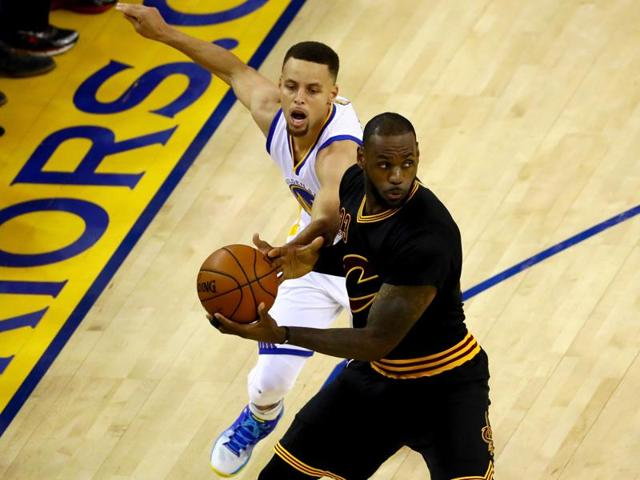 Cleveland Cavaliers guard Kyrie Irving (2), forward LeBron James (23) both scored 41 points in the crucial game to keep their team's remote hopes of NBA title alive.