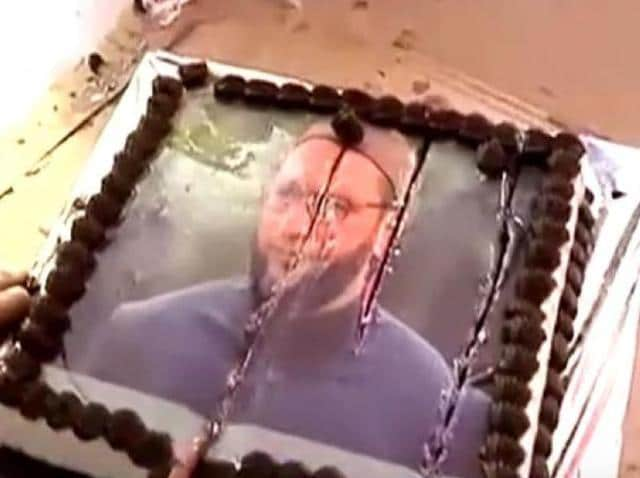 The cake with Owaisi's image on it was cut by some of MNS supporters in the residence.
