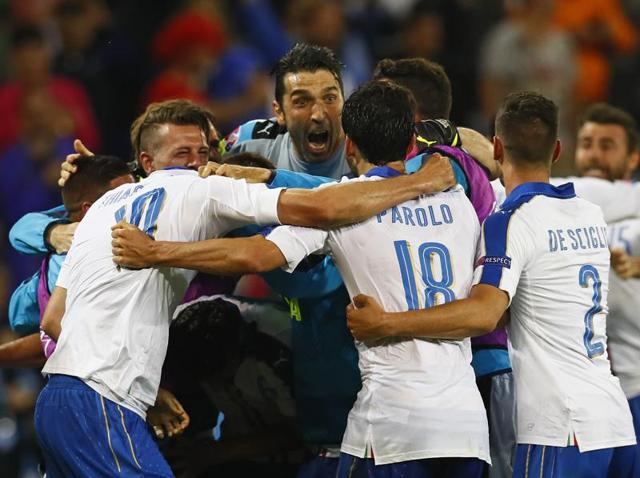 Graziano Pelle celebrates after scoring Italy's second goal.