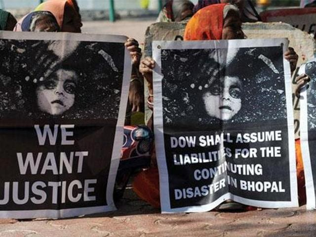 Bhopal gas disaster survivors hold posters during a protest rally in the city.