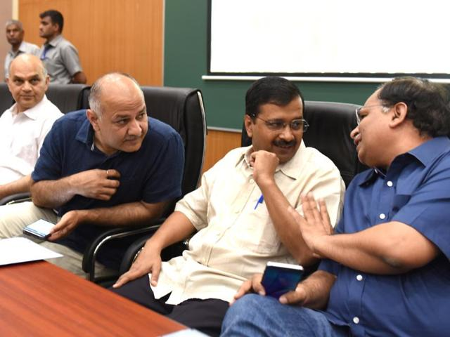 Delhi  assembly speaker Ram Nivas Goyal with chief minister Arvind Kejriwal and deputy chief minister Manish Sisodia arrive at the Delhi assembly.
