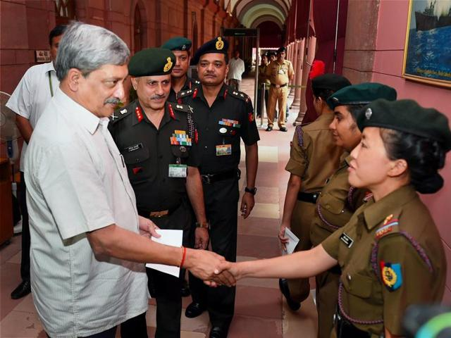 Defence minister Manohar Parrikar shakes hands with NCC cadets who successfully scaled Mt Everest, during a meeting in South Block, in New Delhi on Tuesday.