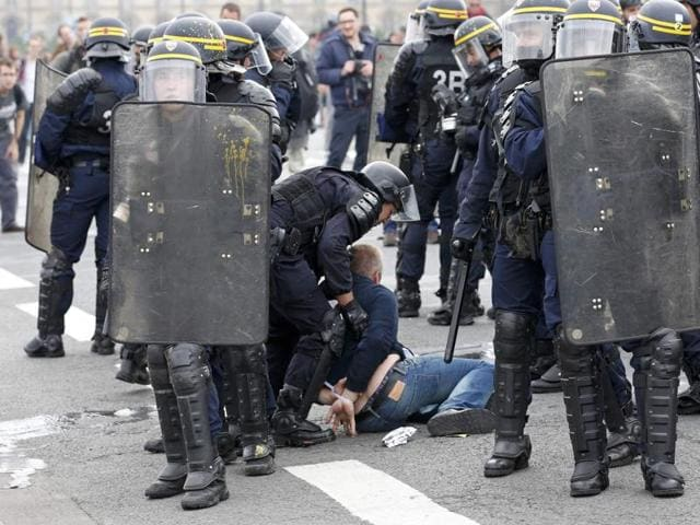 French CRS riot police apprehend a demonstrator during clashes during a demonstration in Paris as part of nationwide protests against plans to reform French labour laws, France, June 14, 2016.