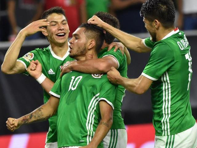Mexico's Jesus Manuel Corona celebrates with teammates after scoring against Venezuela.