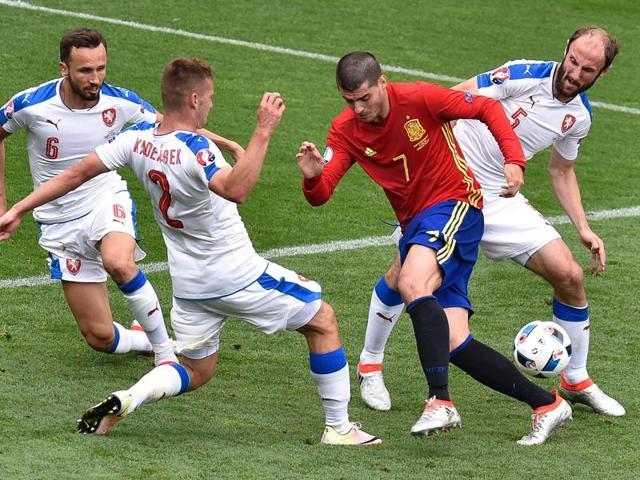 Czech Republic's goalkeeper Petr Cech (L) saves a shot attempt by Spain's forward Alvaro Morata.