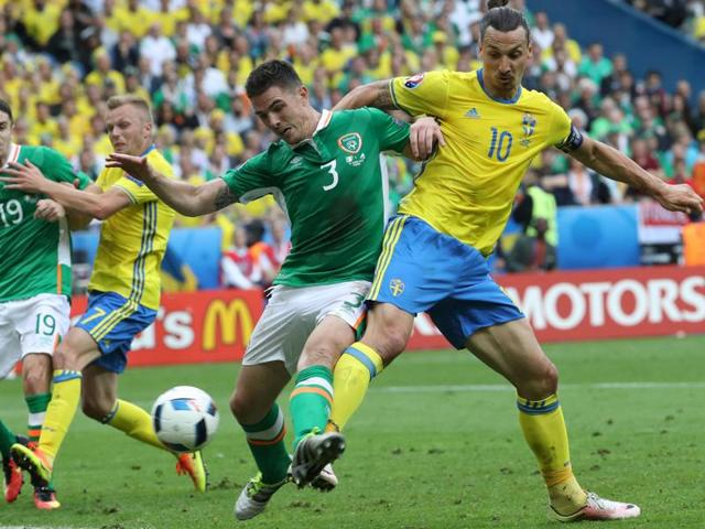 Robert Brady and Ireland's midfielder Wesley Hoolahan celebrate the opening goal during the Euro 2016 match.