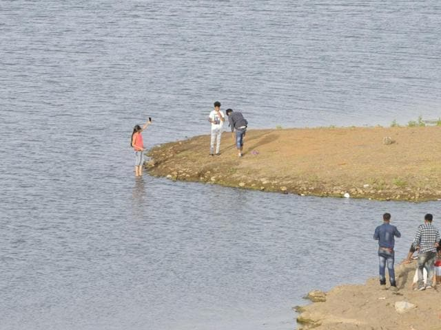 Youngsters on the banks of Kaliasot dam in Bhopal.