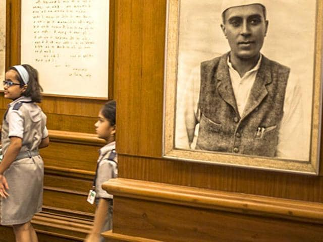 Children walk past a photograph of former prime minister Jawaharlal Nehru at the Nehru Memorial Museum in Delhi.