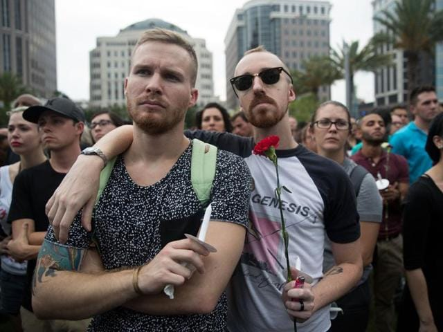 ORLANDO, FL - JUNE 13: People attend an evening memorial service for the victims of the Pulse Nightclub shootings, at the Dr. Phillips Center for the Performing Arts, June 13, 2016 in Orlando, Florida.