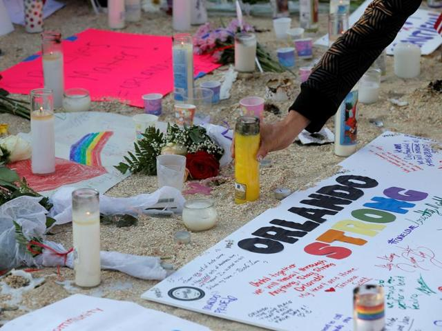 Candles are being lit at a vigil for the victims of the shooting at the Pulse gay nightclub in Orlando, Florida.