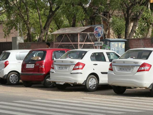 Four-wheelers parked in no parking zone in Jaipur.
