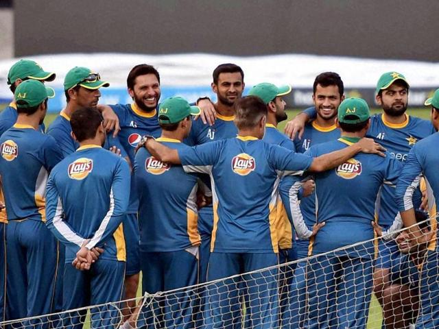 Pakistan cricketers hold a team meeting during their training session at the Eden Gardens in Kolkata.