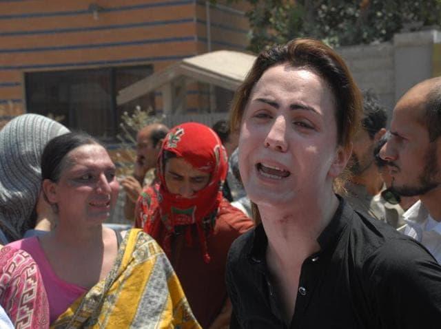 Pakistani transgender Paro mourns the death of her colleague Alisha, in Peshawar, Pakistan. Alisha was shot five times allegedly by her boyfriend.