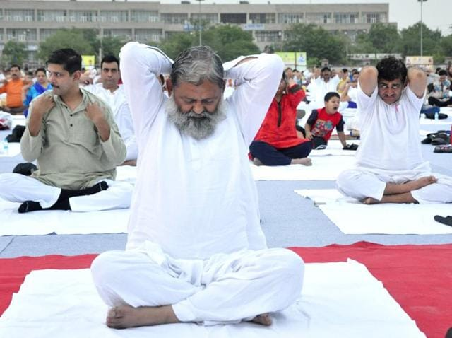 Haryana health minister Anil Vij at a yoga camp lead by Baba Ramdev at Parade Ground in Sector 5, Panchkula.