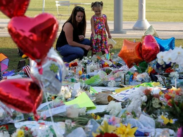 Tony Backe, of Orlando, lights candles at a makeshift memorial for victims of the mass shooting at Pulse gay nightclub on Tuesday.