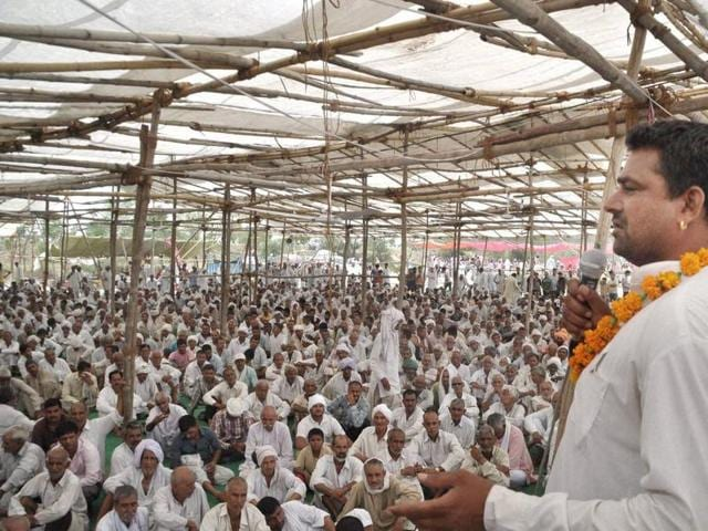 A Jat leader addresses protesters in Rohtak.