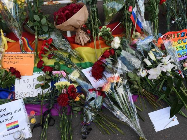 Notes and flowers for the victims of a mass shooting at a gay nightclub in Orlando are seen in front of the US embassy in Moscow.
