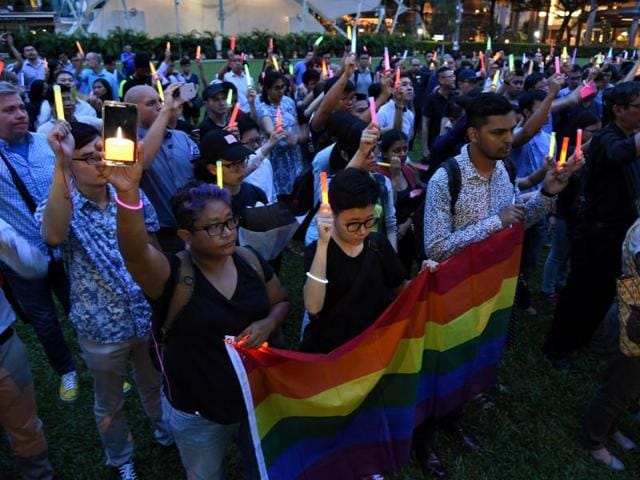 People join a vigil for the victims of the Orlando shooting in Florida, in Singapore on June 14, 2016.