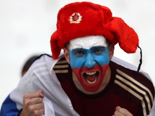 A Russian fan cheers for his national team before the Euro 2016 Group B match.