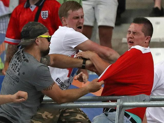 Russian supporters attack an England fan at the end of the Euro 2016 Group B match.